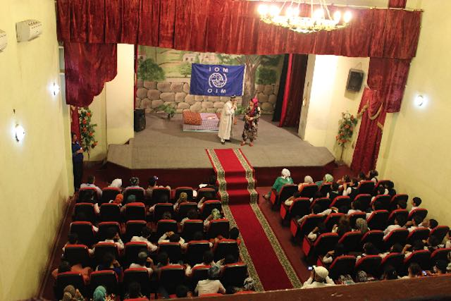 Through series of theatrical performances IOM Tajikistan teaches audience about the threat of human trafficking by showing real problems and the current forms of trafficking in persons, as well as how to keep themselves and their families safe from traffickers. Qurghonteppa, 20 May 2016. Photo by Abdulfattoh Shafiev