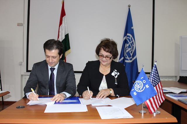 "The International Organization for Migration represented by Mr Dragan Aleksoski, IOM Tajikistan Chief of Mission, (left) and the Tajikistan Network of Non-Governmental Organizations ""Umed"" represented by Ms. Sanoat Solieva, NGO ""Femida"" founder, (right) signed a memorandum on cooperation to protect migrants' rights and counter human trafficking. Dushanbe, 21 December 2016. Photo by Abdulfattoh Shafiev"